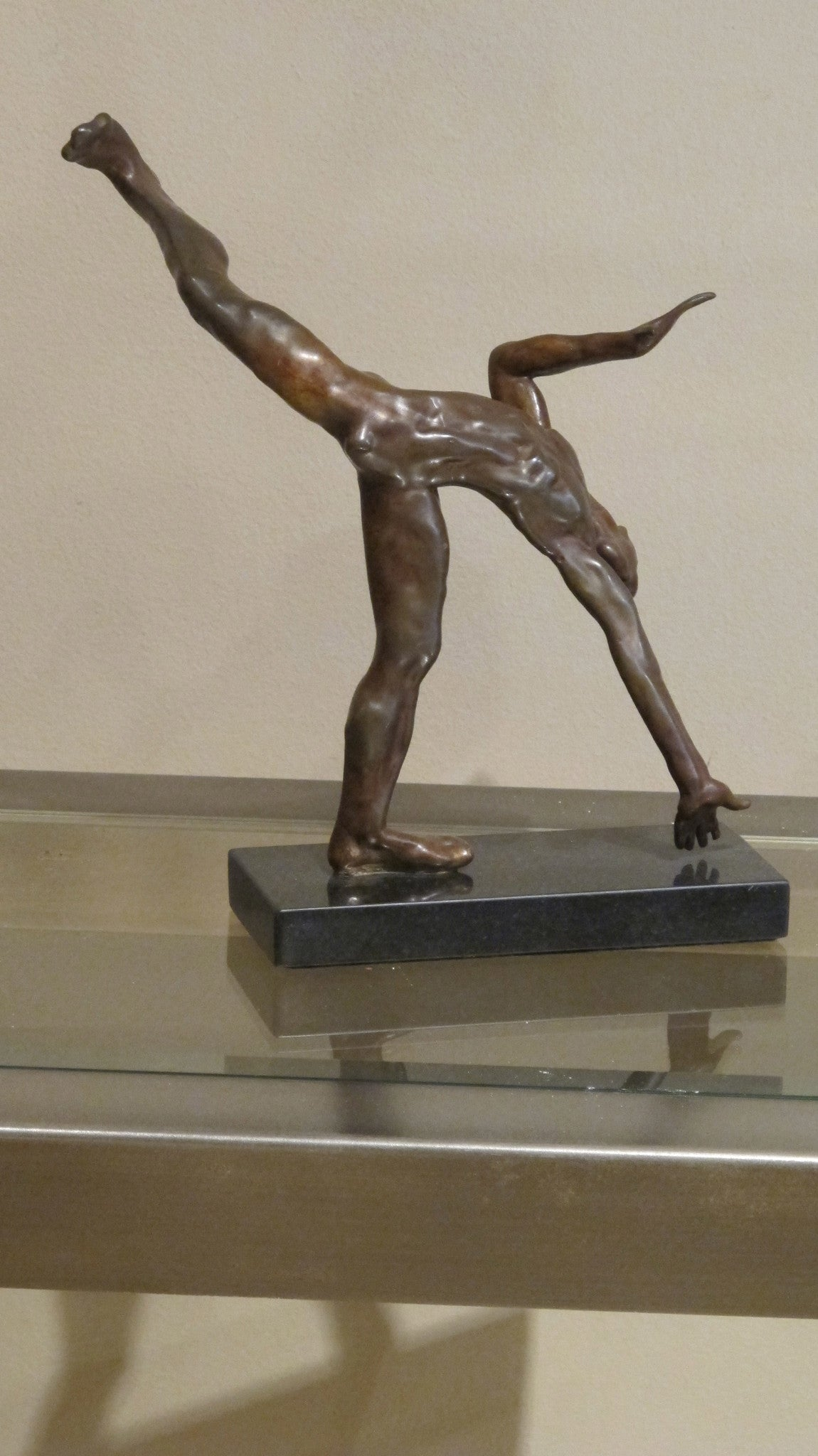 A pair of bronze studies of  male performers by J.W. Mills PPRBS ARCA FRSA dated 76