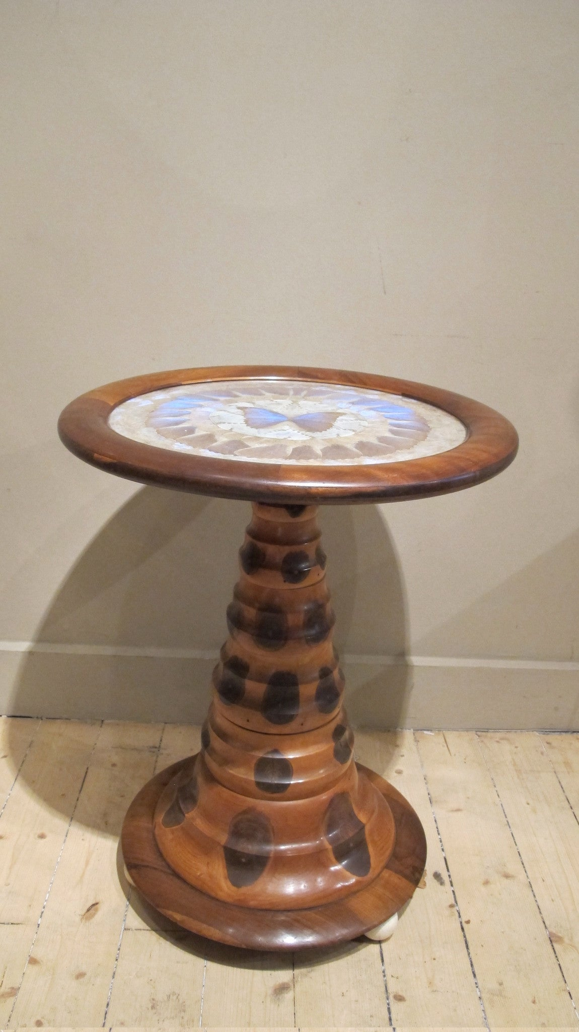 X Mid 20th-century Brazilian monkey puzzle wood table with circular top inset with butterflies