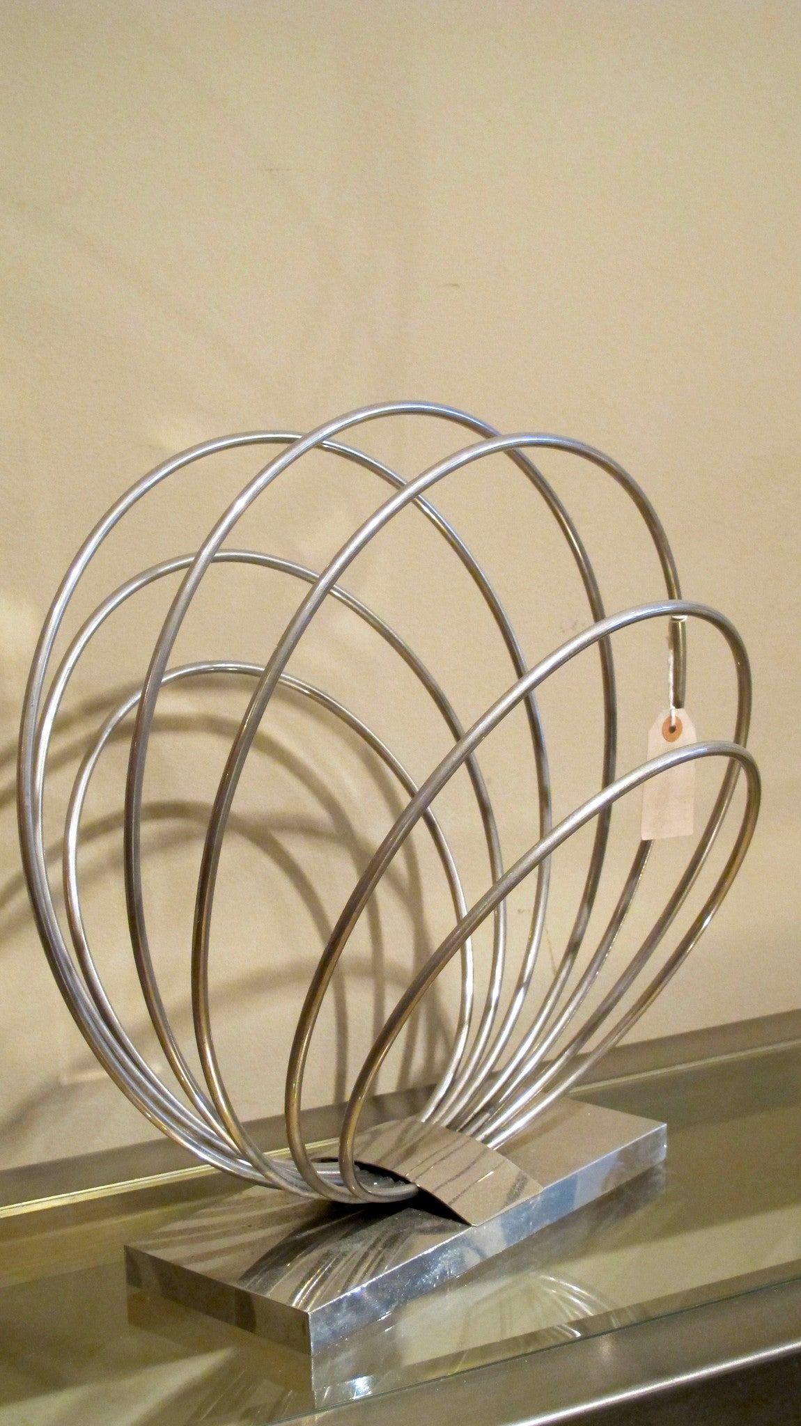 A chrome modernist Italian magazine rack.