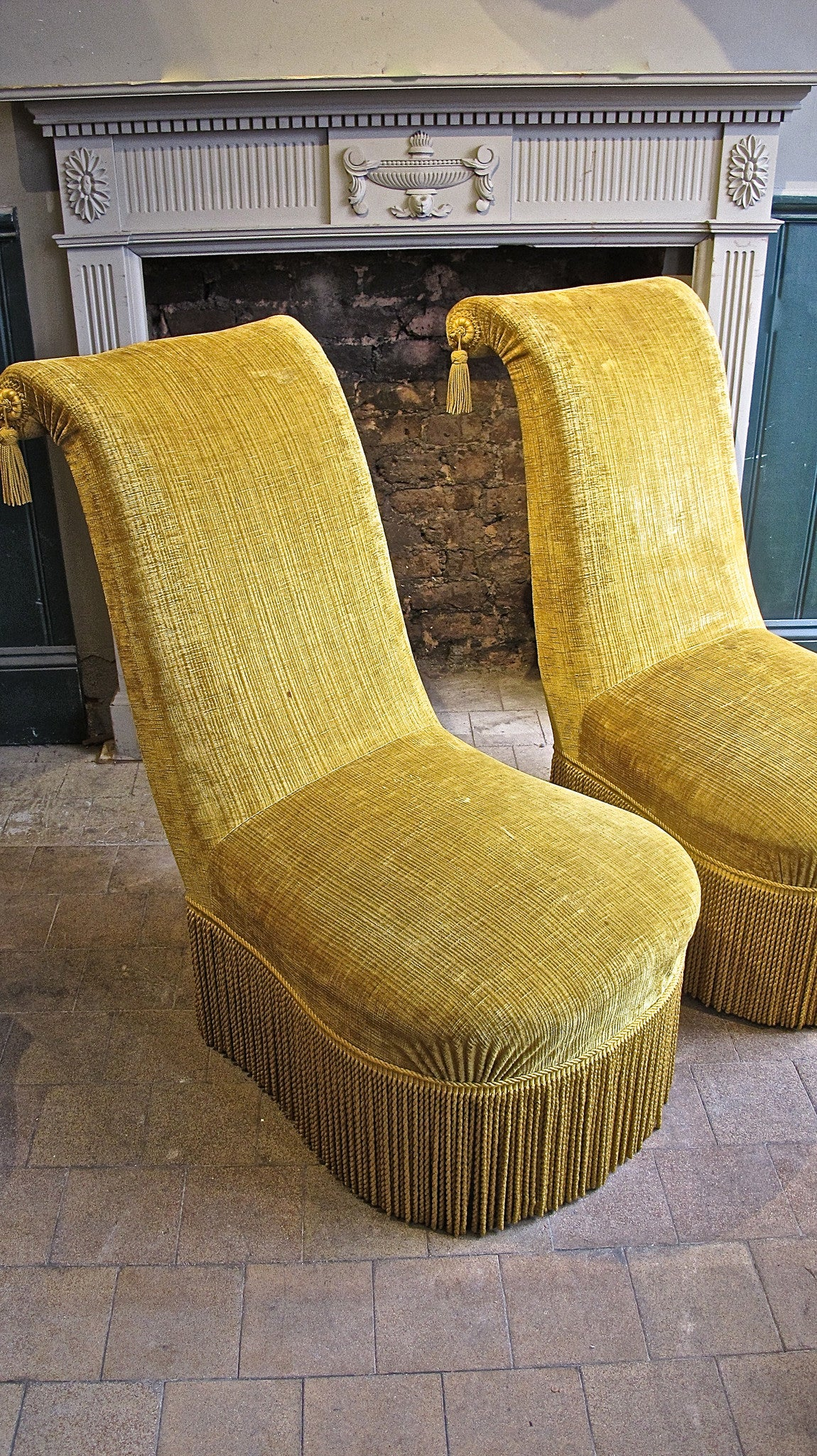 X Pair of french 19th century chairs with sweeping backs and tassel detail