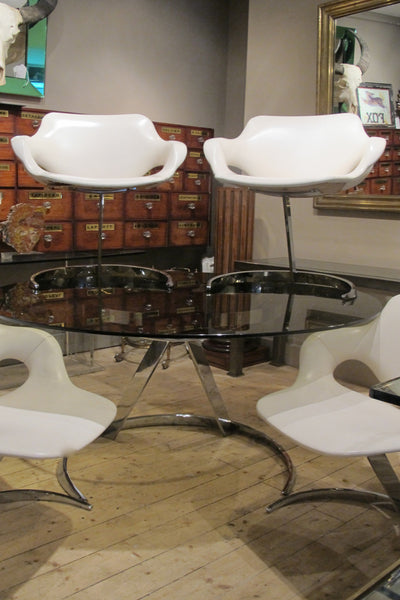 Boris Tabacoff cantileverd  Glass  top Table with four matching chairs.