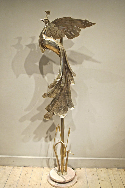 An Italian bronze floor lamp in the form of a peacock over bullrushes.
