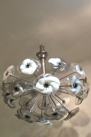 A large and impressive 1970s murano glass chandelier modelled as glass flowers on a chrome frame.