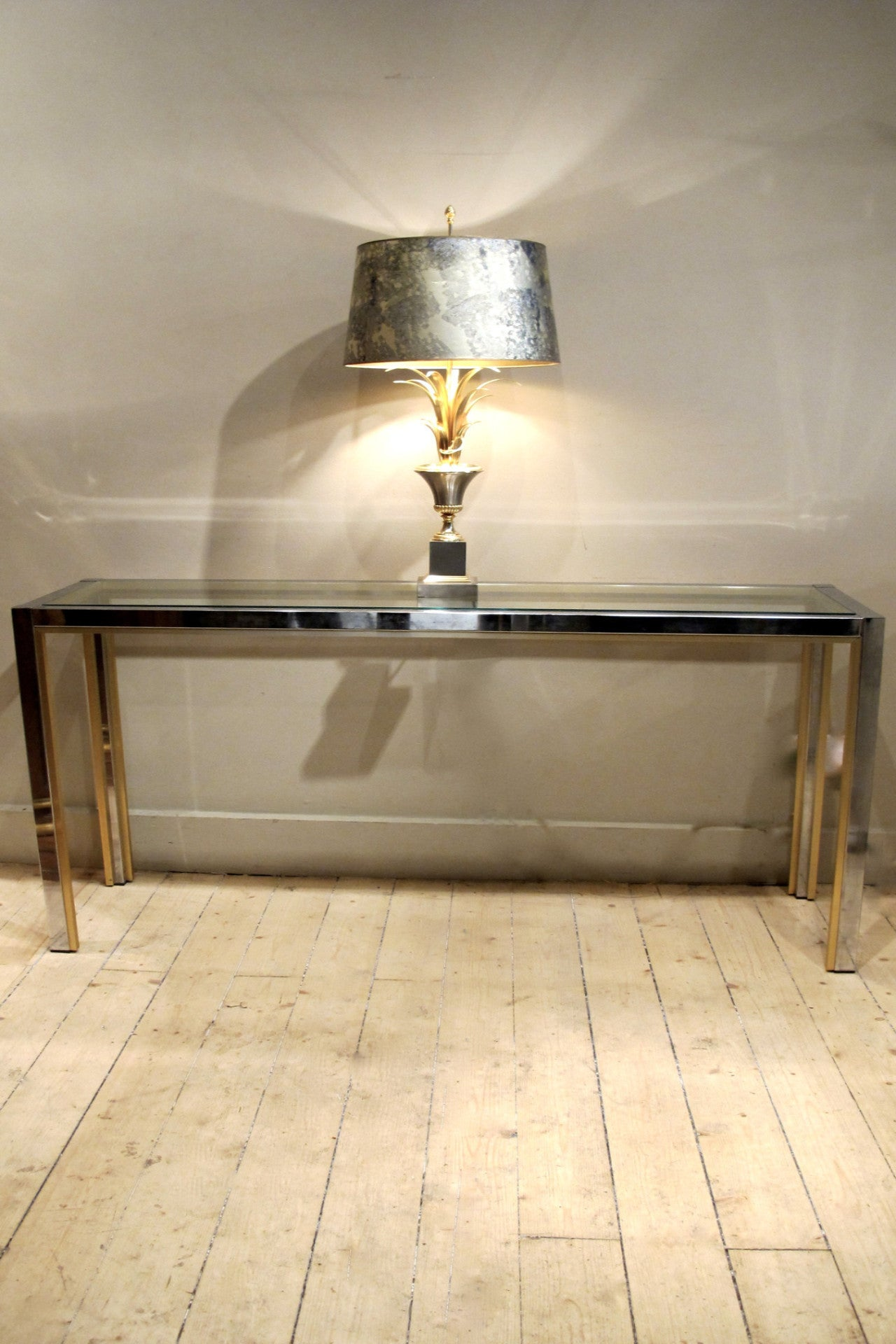 A large chrome 1970s console with brass edge detail