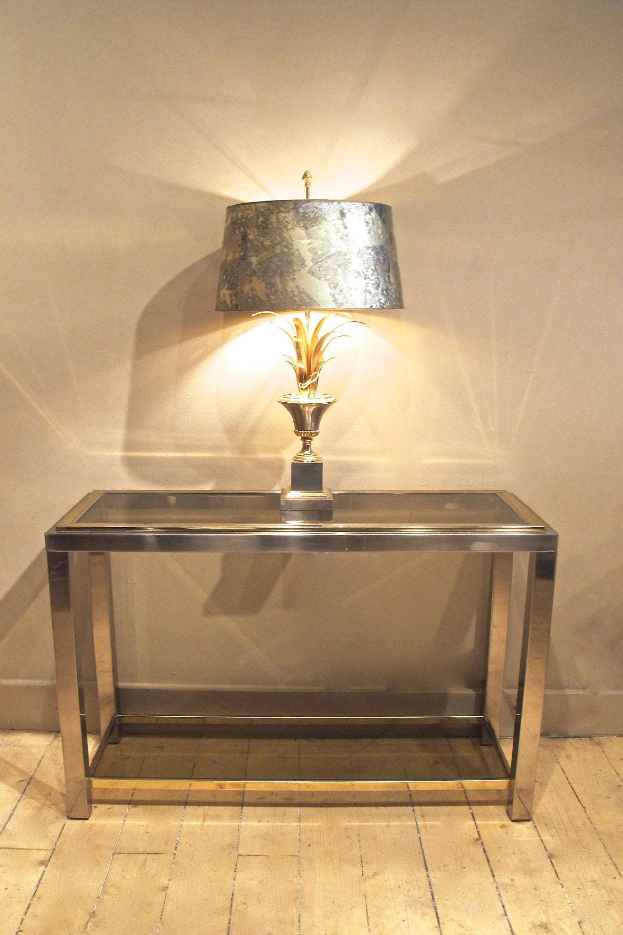 A 1970s brass and chrome console of petite size.