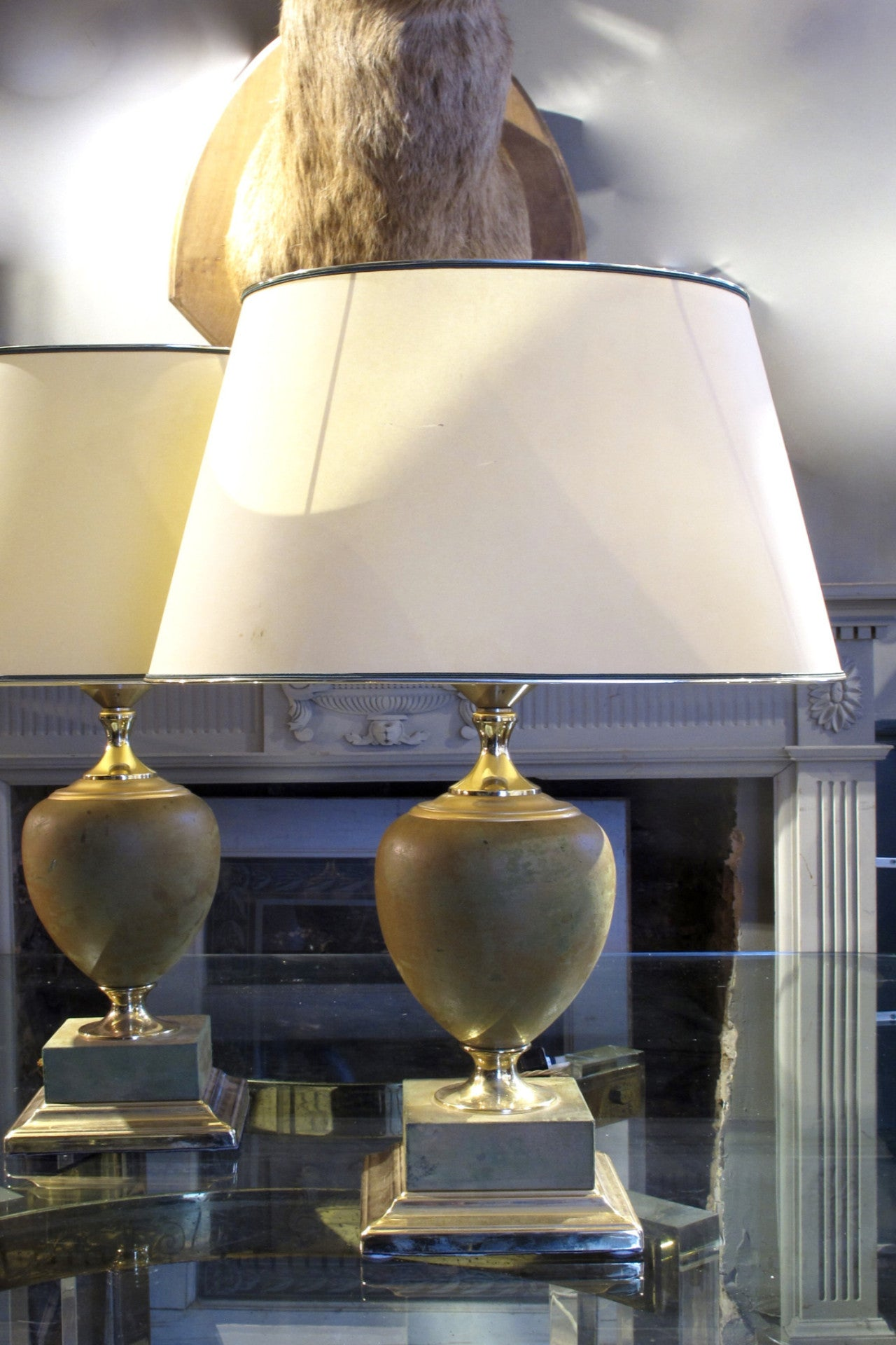 X a pair of 1970s leather wrapped table lamps with brass bases.