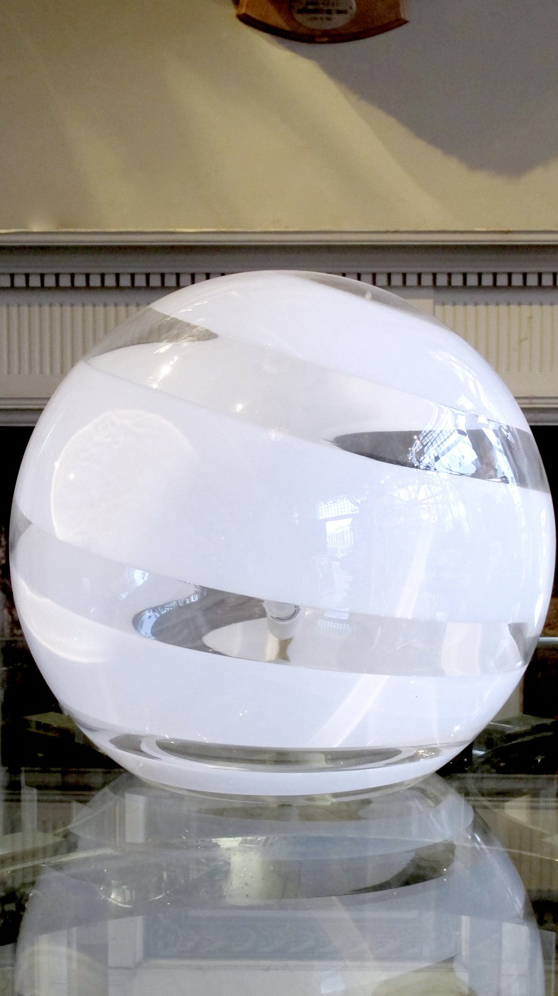 late 1970s glass ball table lamp with white swirl.