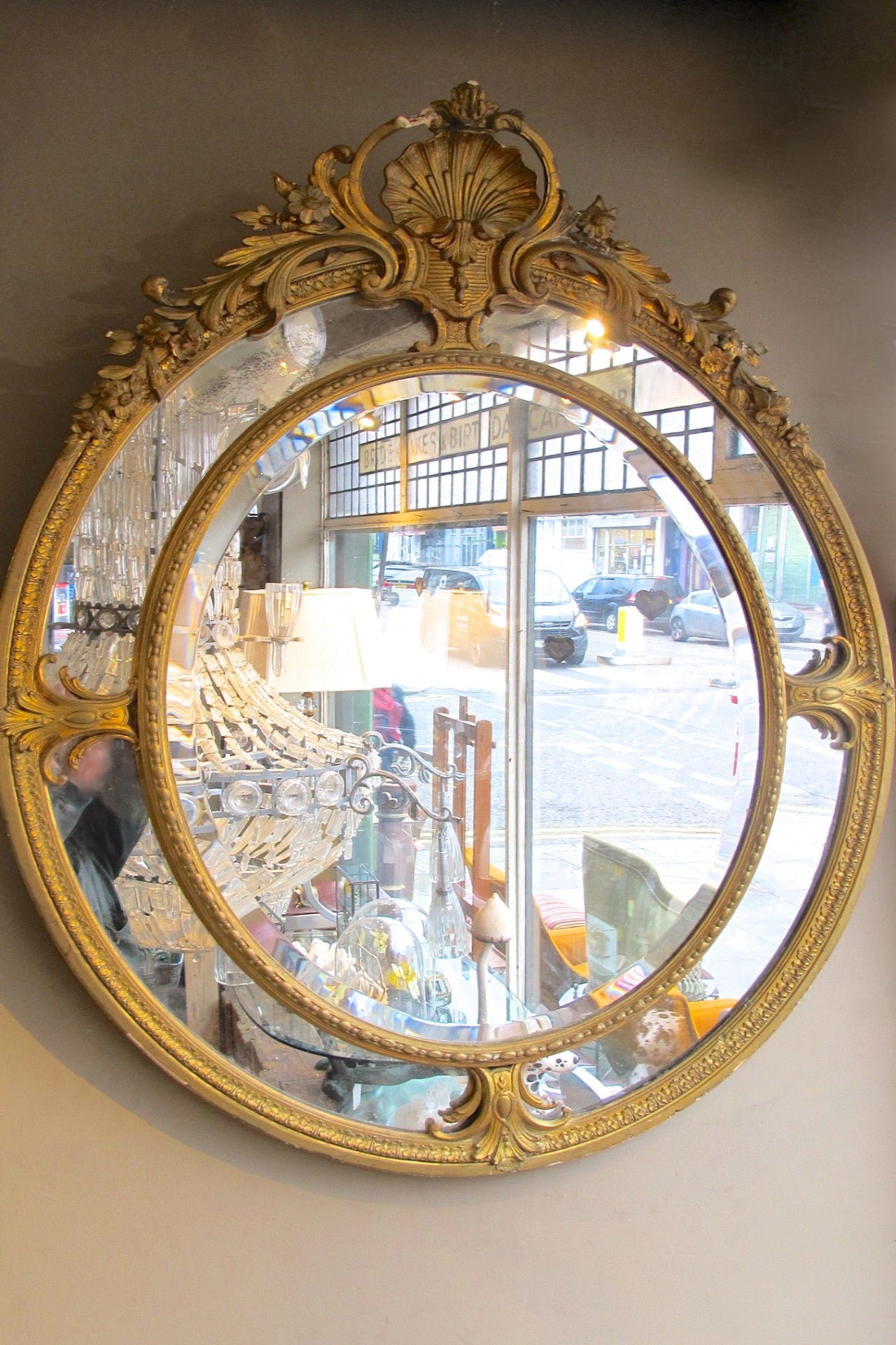 X French Oval Louis XVI Style Gold  Mirror with mercury glass.