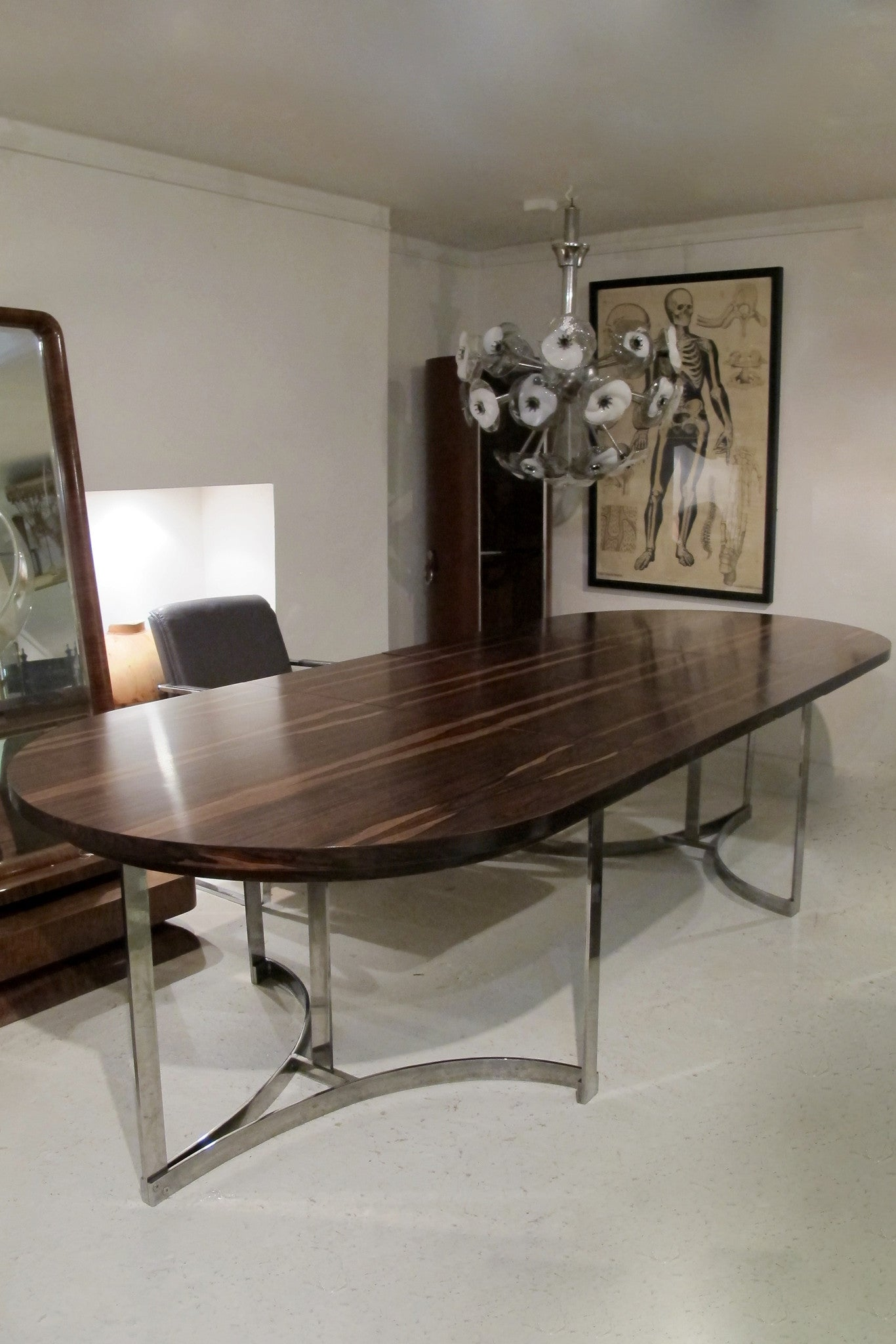 X Exceptional , extending, Merrow Associates Rosewood and Chrome Dinning Table Designed by Richard Young.