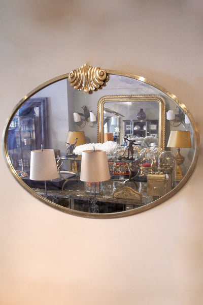 A large 1960s oval brass framed italian mirror.