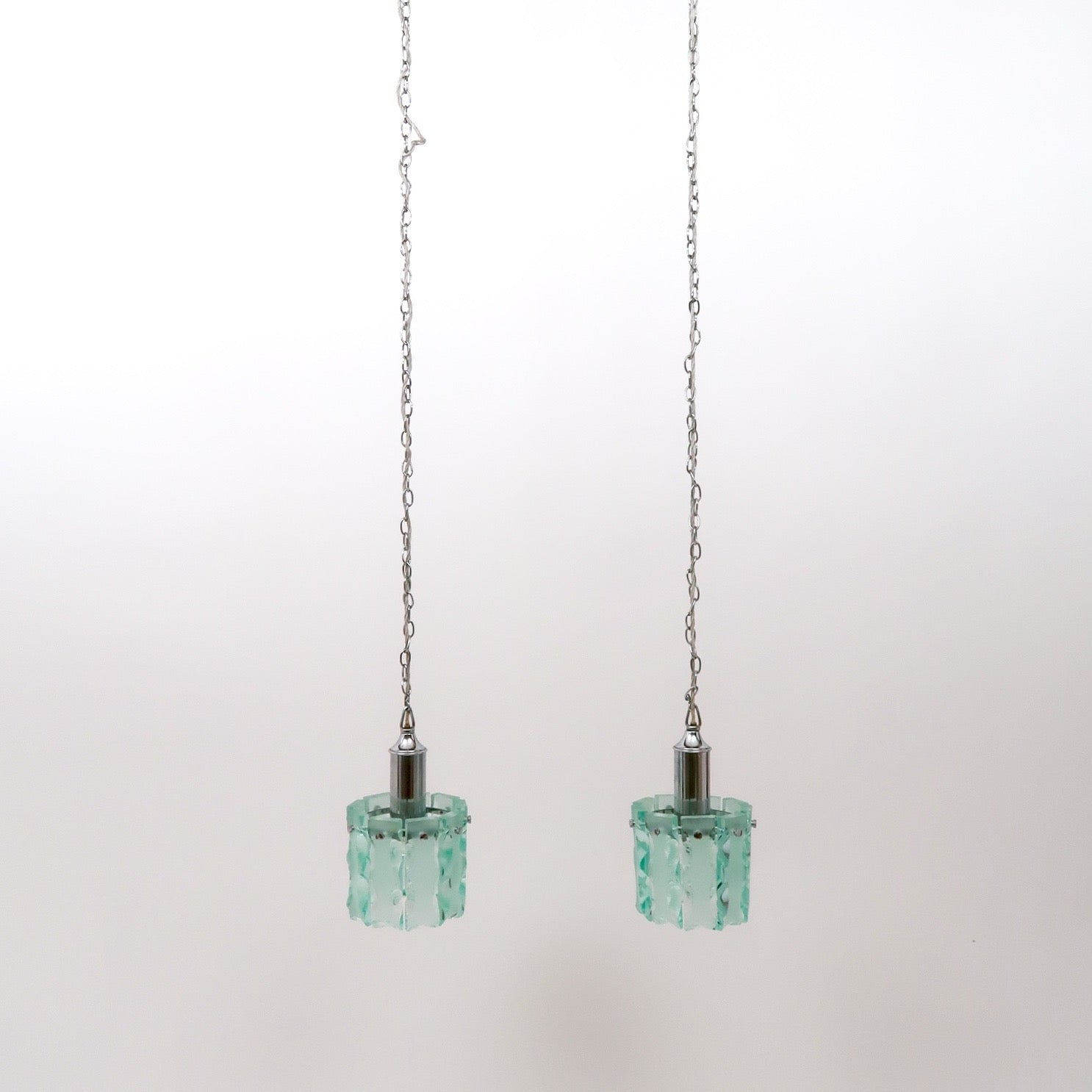 Pair of vintage Italian 1970's chiseled glass pendant lights .