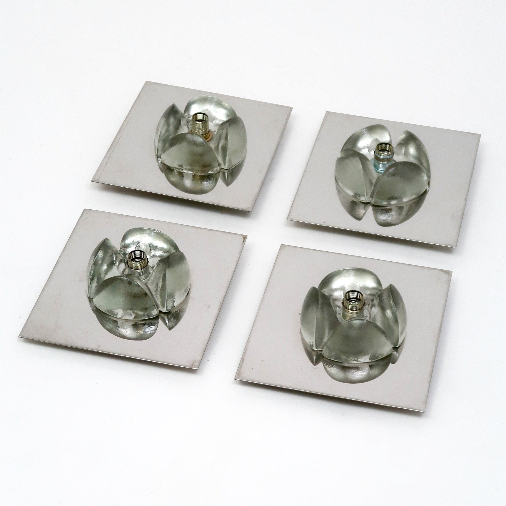 Fabulous stylised vintage glass and chrome wall lights .