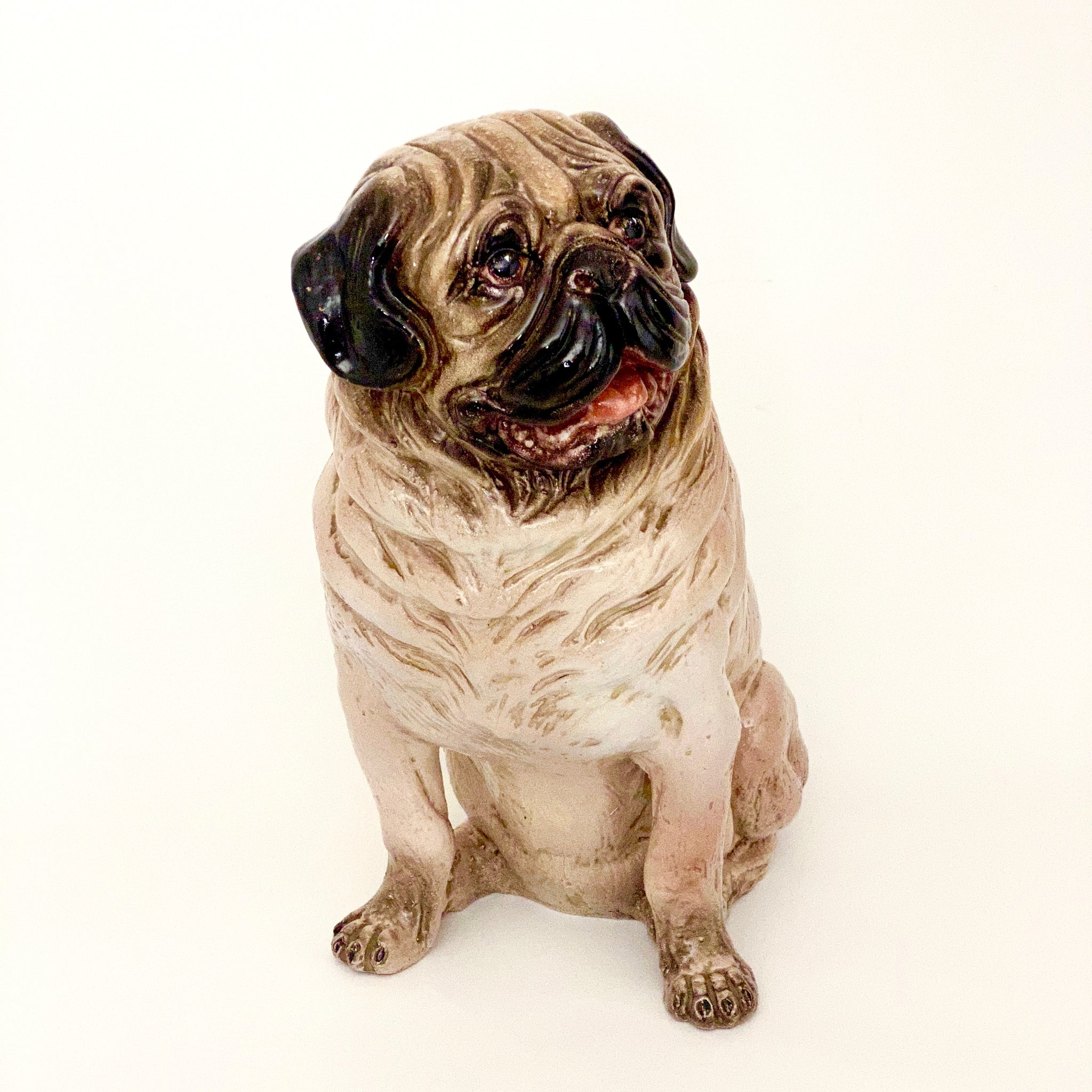 Charming hand modelled glazed ceramic pug circa 1970 .