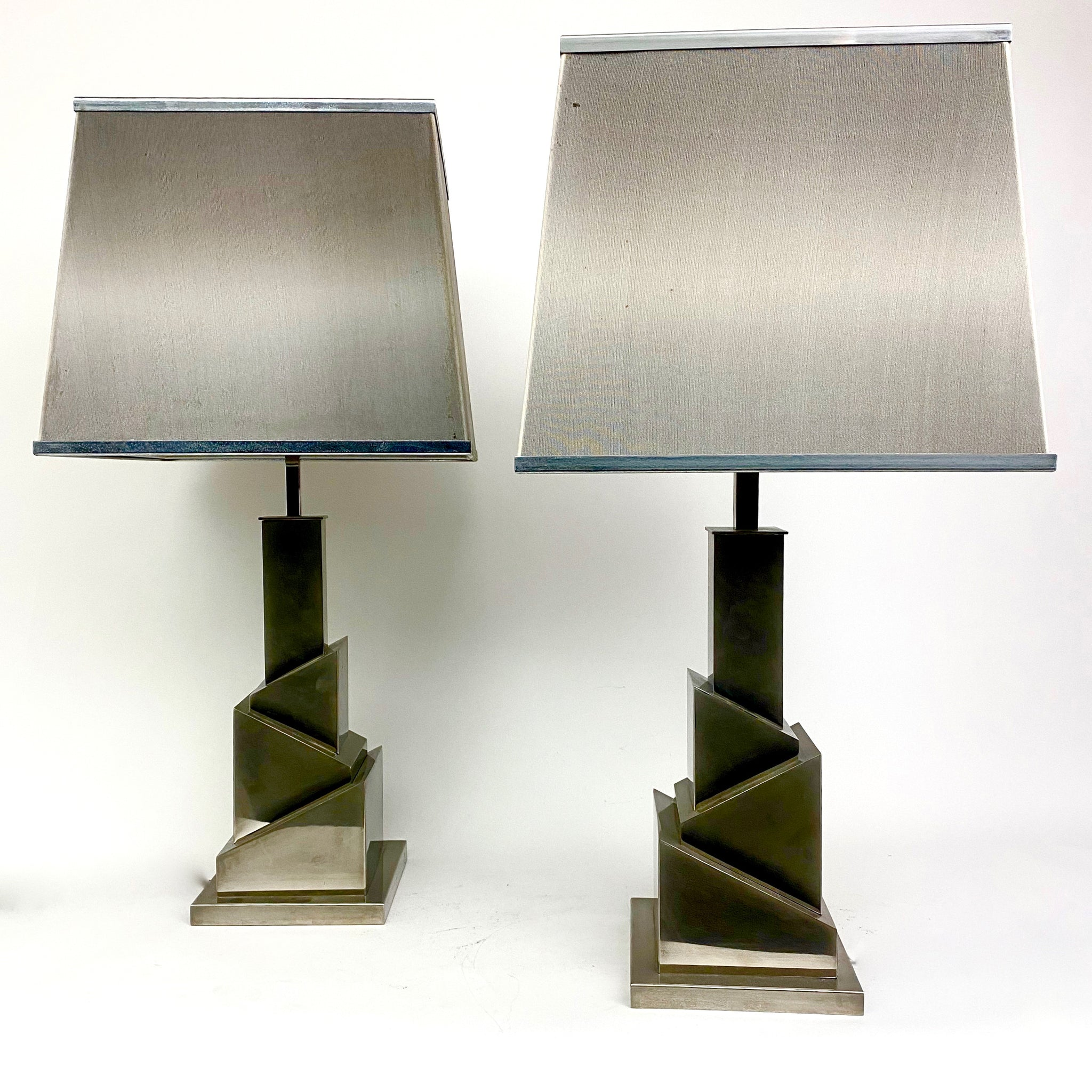 Original signed pair of  skyscaper lamps  by Romeo Rega .