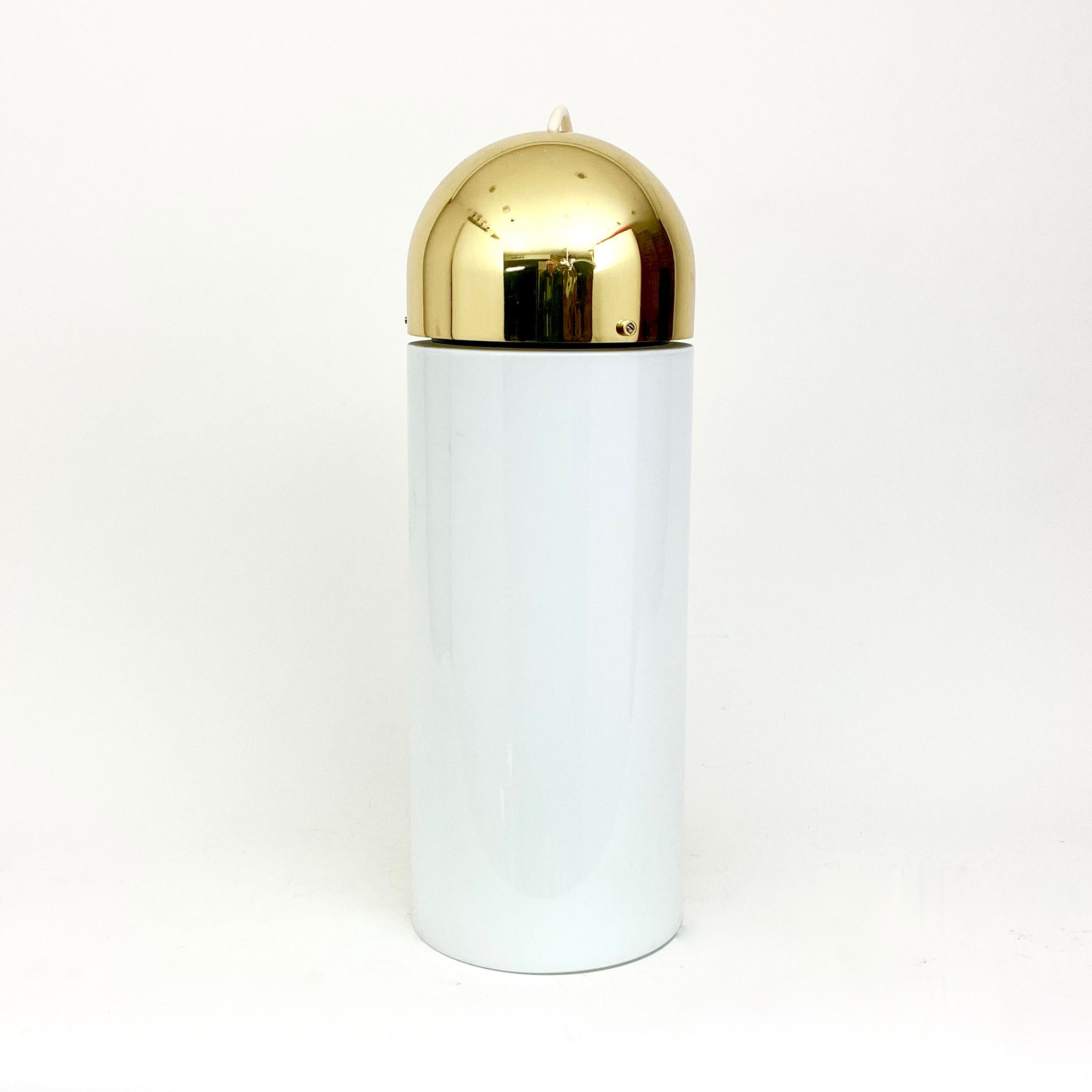 Large  white glass hanging lights with domed brass tops .