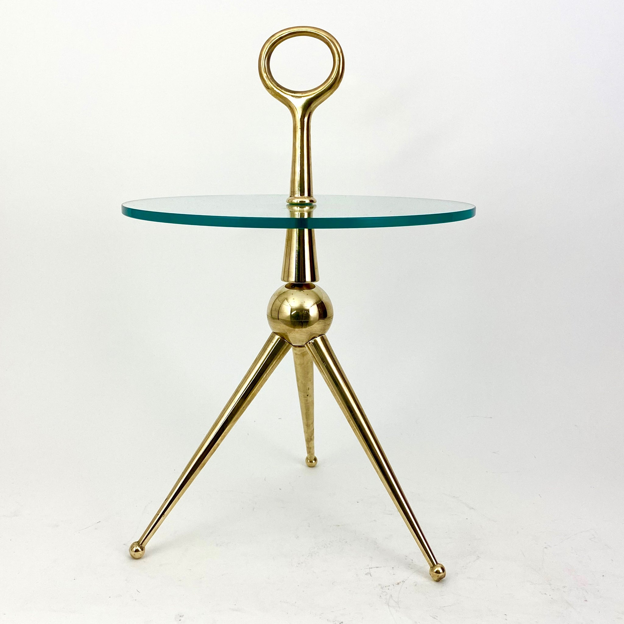 Solid turned brass Italian ' sputnik ' side table .
