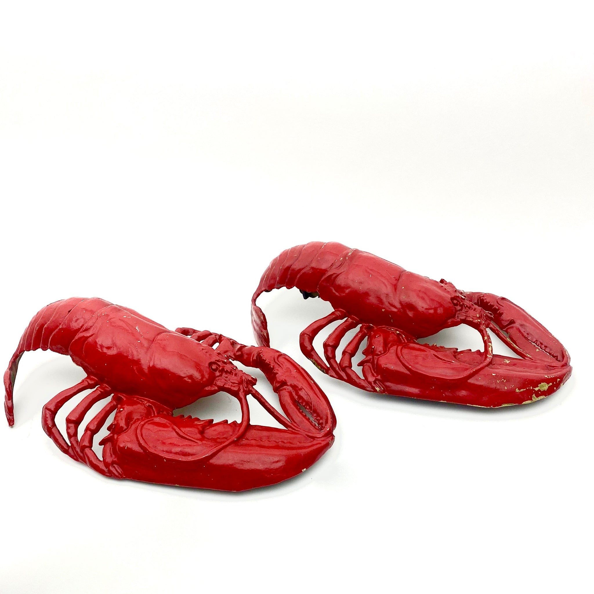 Pair of red metal lobster wall lights circa 1960 .