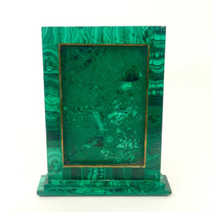 Malachite and brass veneered picture frame .