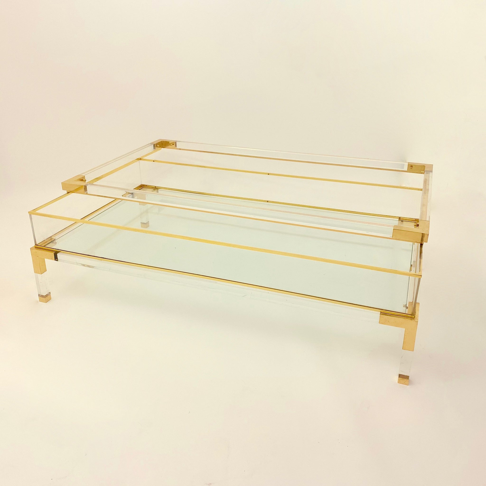 Vintage French perspex and brass coffee table with sliding top .