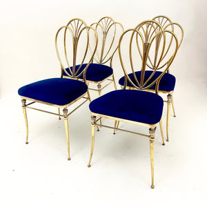 Very stylish set of 4 vintage brass dinning chairs .