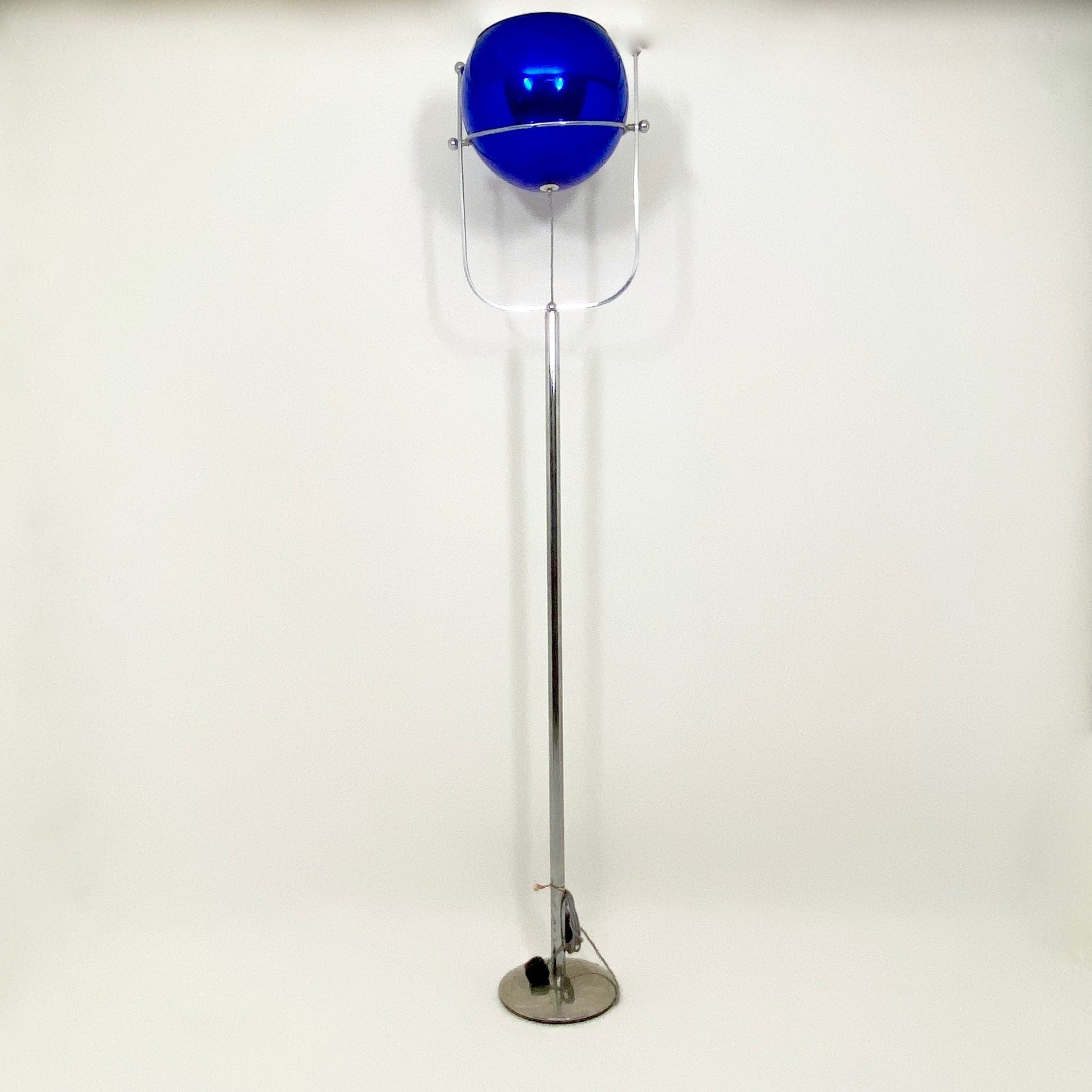 Italian mid century uplighter with adjustable blue glass shade.