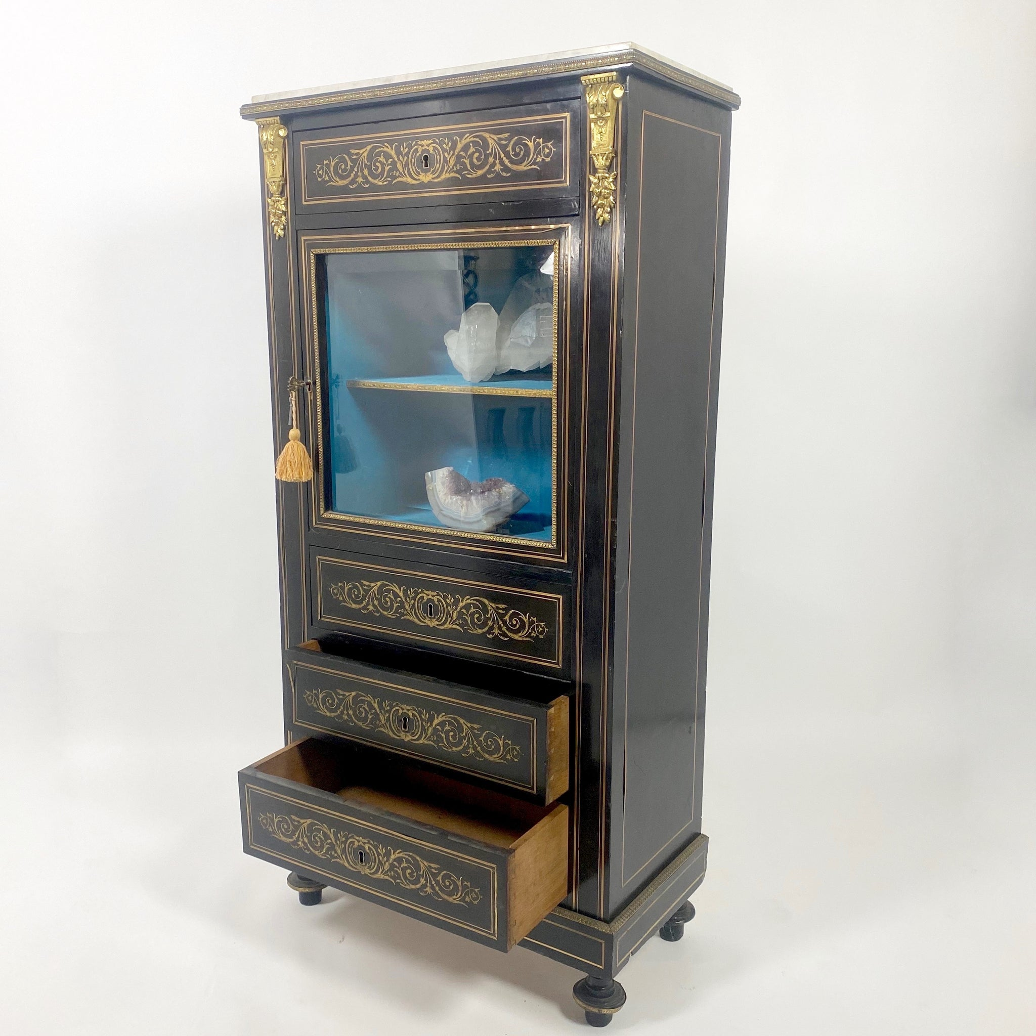 French 19th century ebonised display cabinet with brass inlay .