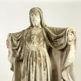 A late 19th century stone statues of Jesus.