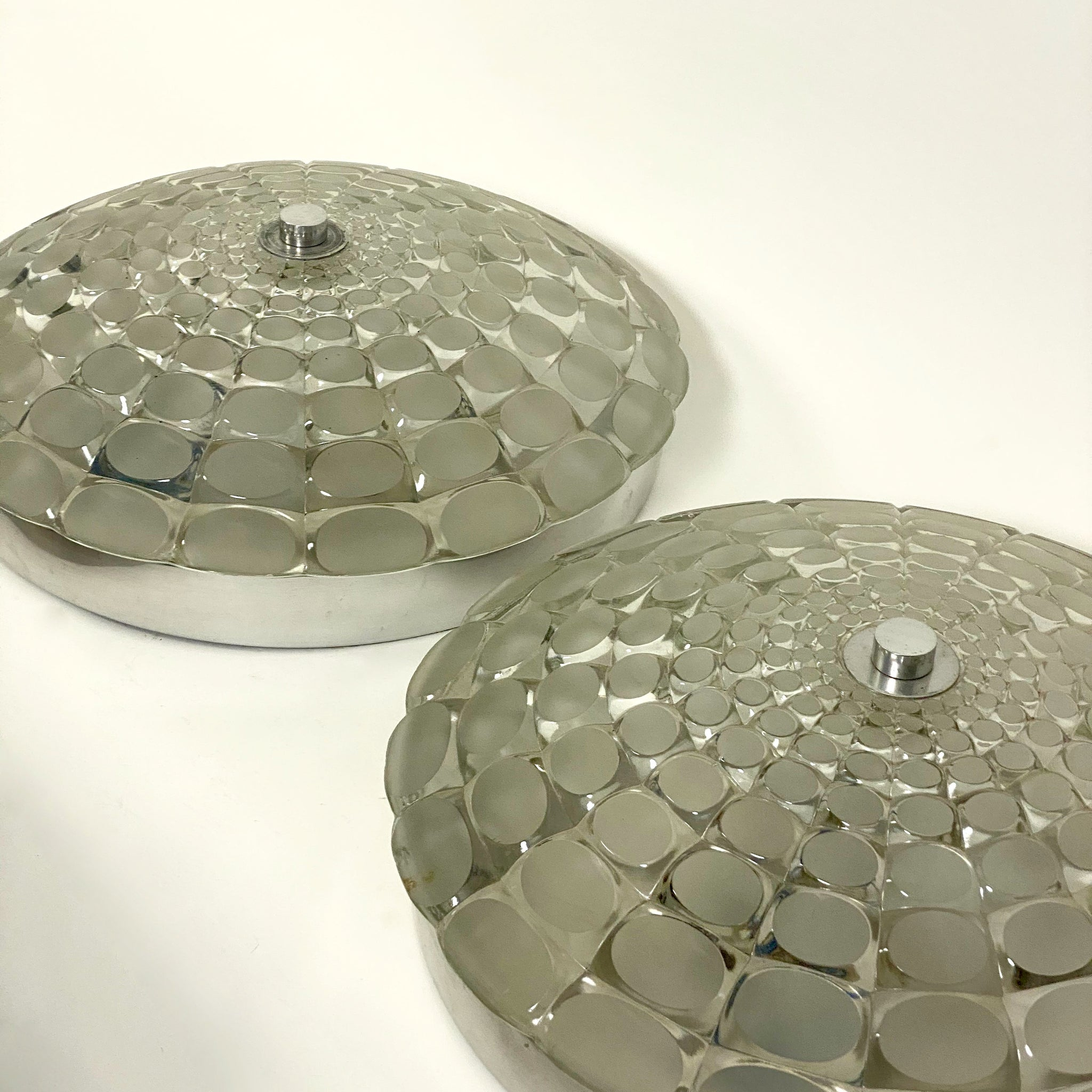 An unusual pair of mid century faceted wall lights circa 1970.