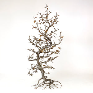 Large Italian hand forged tree sculpture with patinated leaf details .