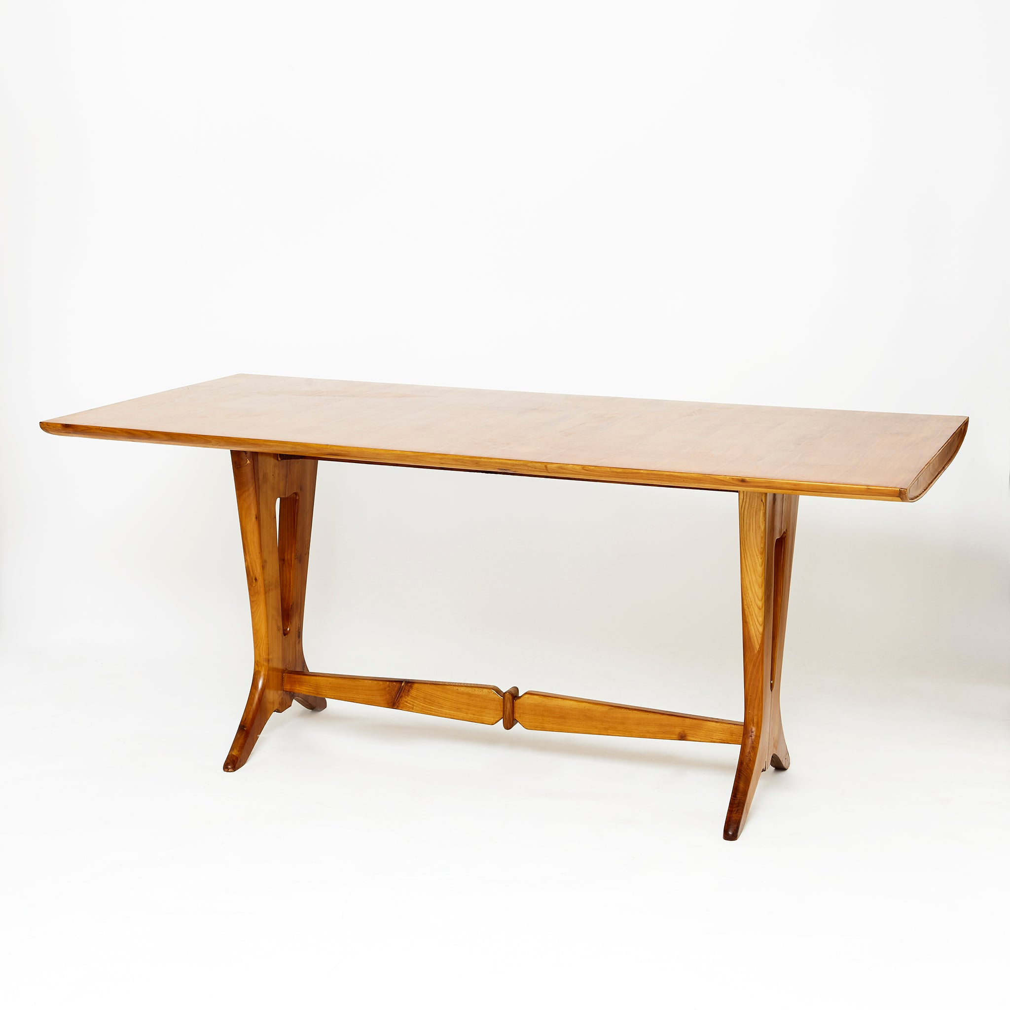 Italian mid century fruit wood dinning table with shaped stretcher.