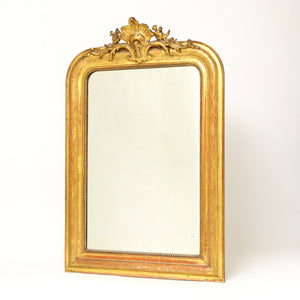 Elegant french 19th century mirror with original gilt finish.