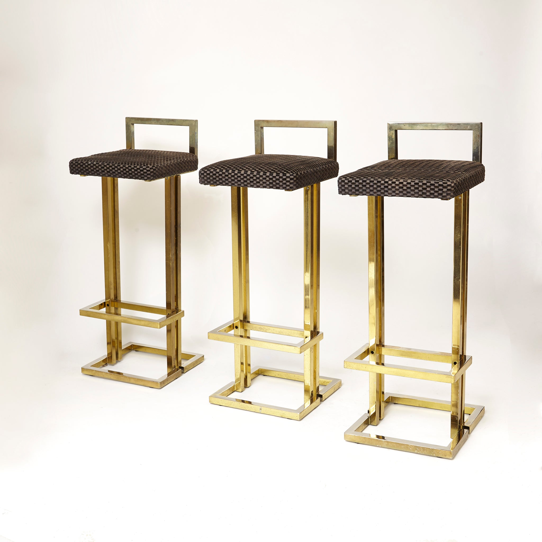 Set of three Maison Jansen bar stools with faded gold finish .