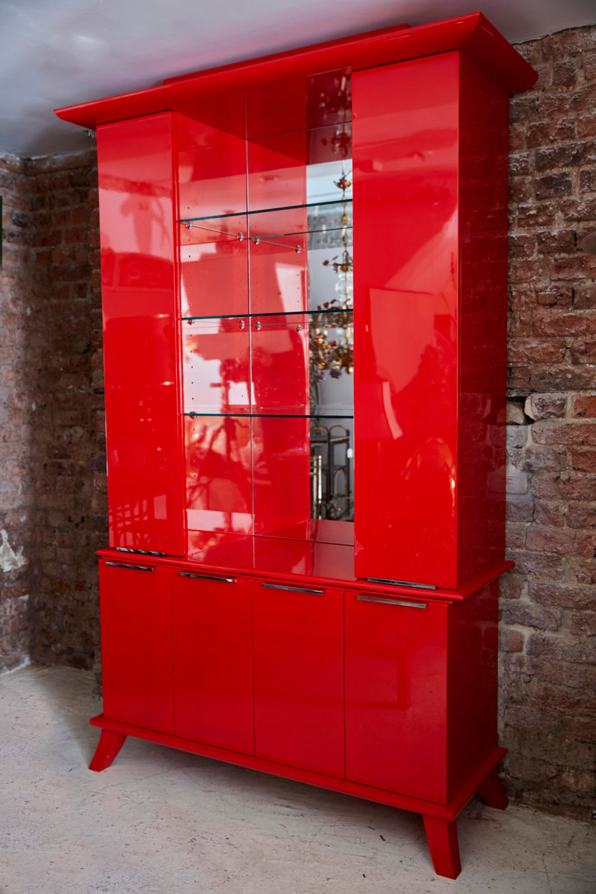 late twentieth century red lacquer cabinet of chinoiserie  influence.