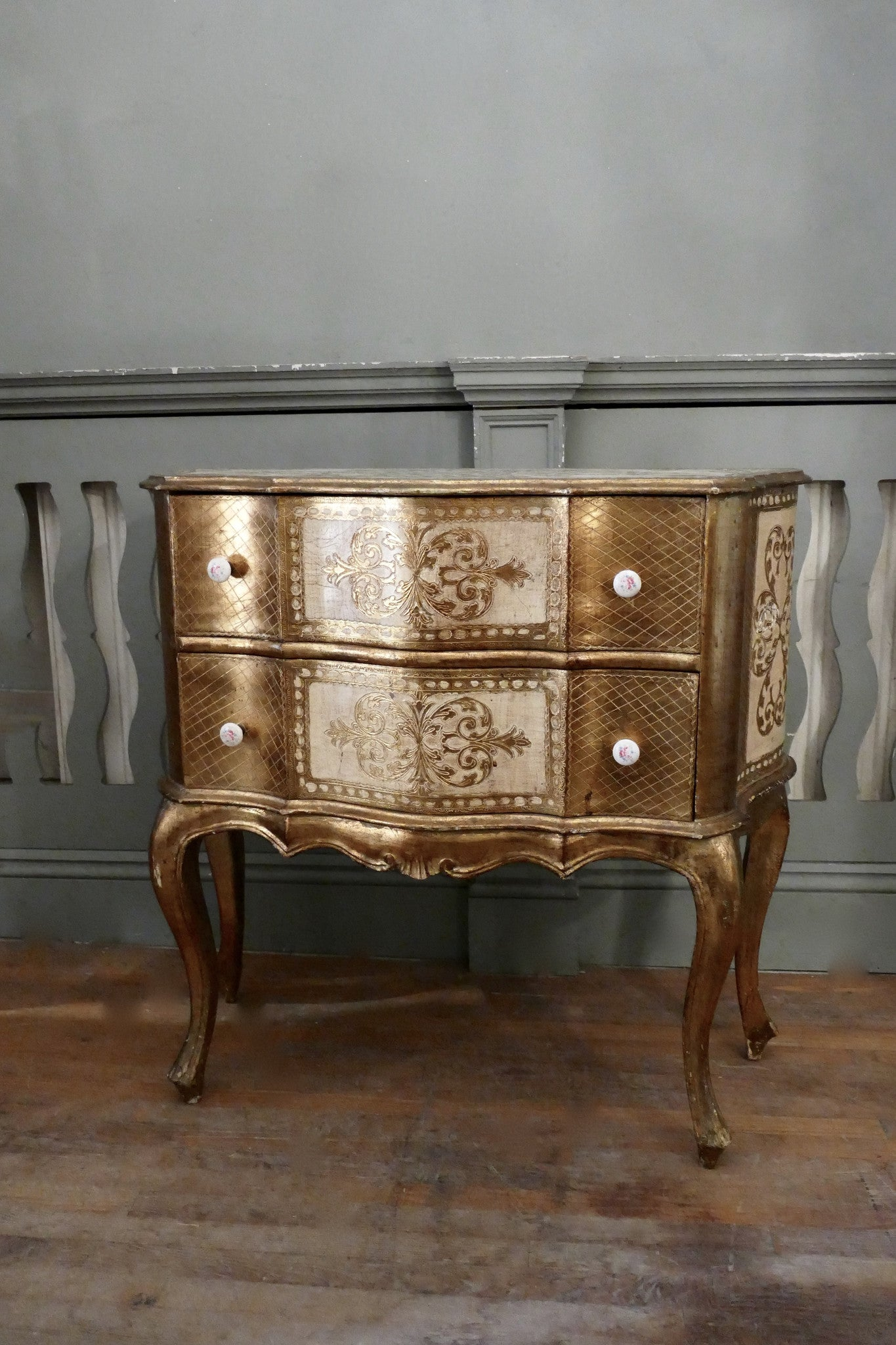 X Serpentine fronted Florentine chest of drawers.