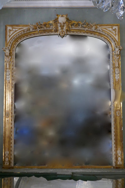 A large Louis XV style  parcel gilt over mantel mirror, 19th Century .