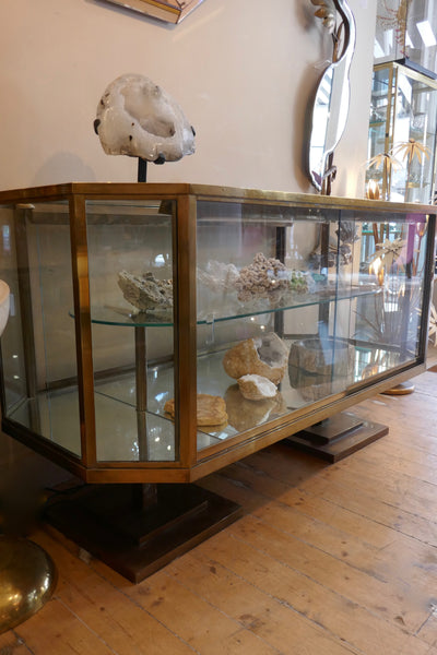 A Fine early twentieth century brass display octagonal cabinet with sliding glass doors
