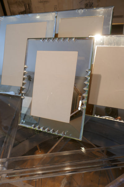 Set of 7 french 1950's mirrored photo frames of various sizes.