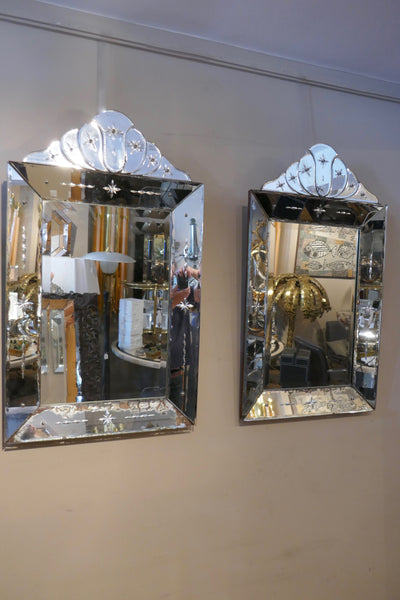 A decorative pair of 1930's continental Venetian style mirrors with crests .