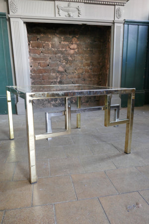 Pair of very decorative 1970's side table with gold and chrome details.