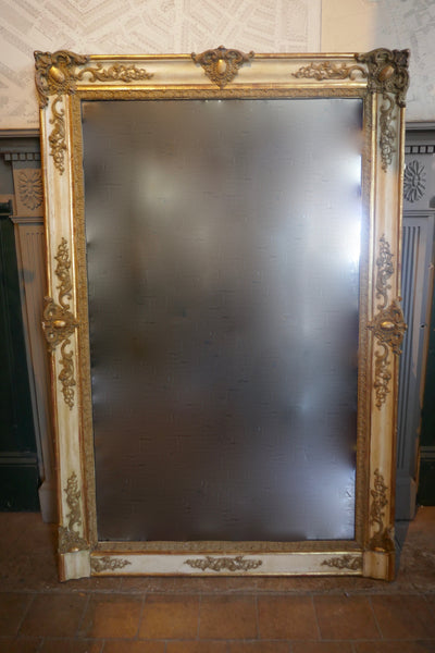 Highly decorative french mirror with original parcel gilt finish and original glass.