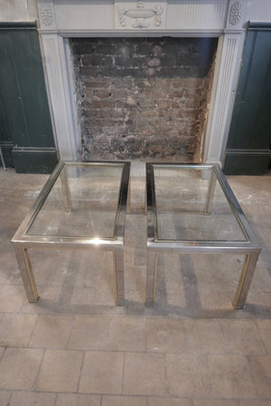 a 1970's chrome and gold coffee table with two undertables in the Romeo Rega style