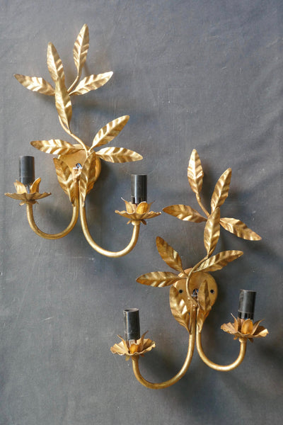 Pair of decorative Italian wall lights with naturalistic leaf decorations.