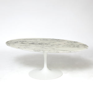 Eero Saarinen tulip coffee table with Arabescato marble top .