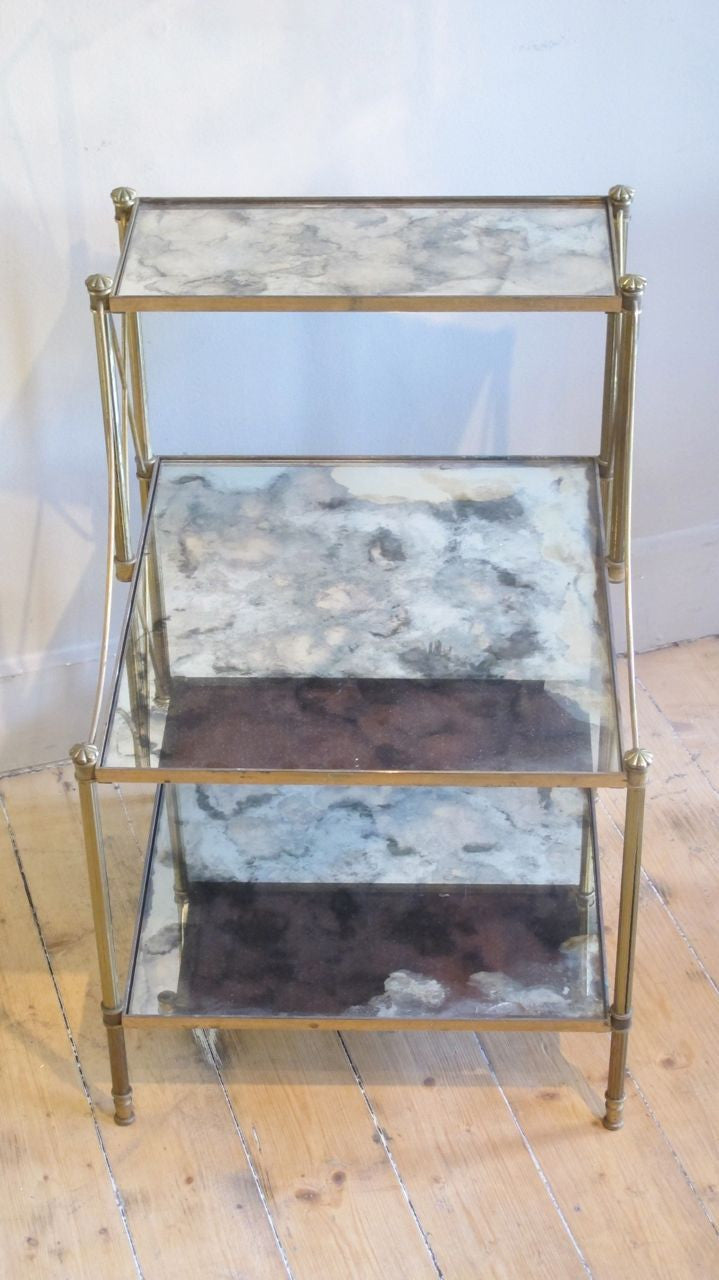 X Pair of superb quality french  brass 3 tier Side Tables with original mirrored shelves .