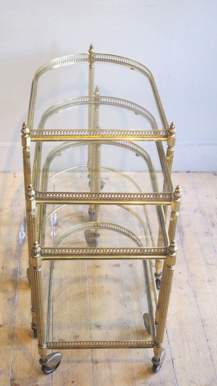 Decorative three tier brass nest of tables.