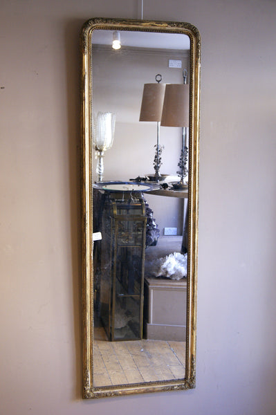 Long french 19th century pier mirror with mercury glass plate