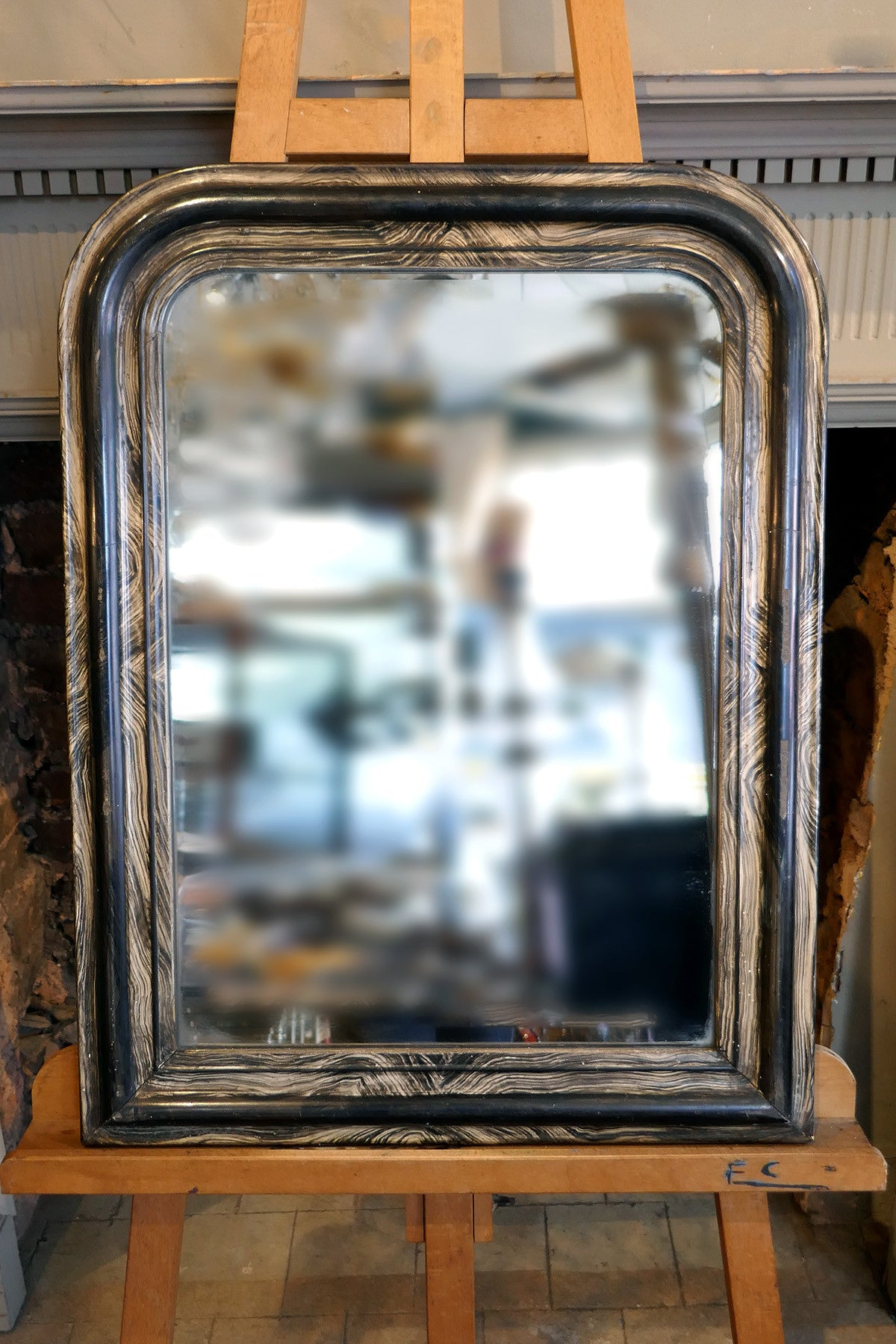 Distressed french mirror with original plate circa 1900.