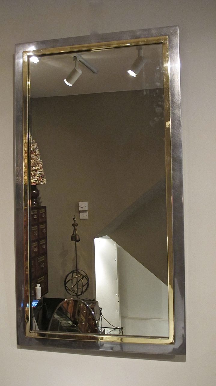 X 1970s steel and brass wall mirror