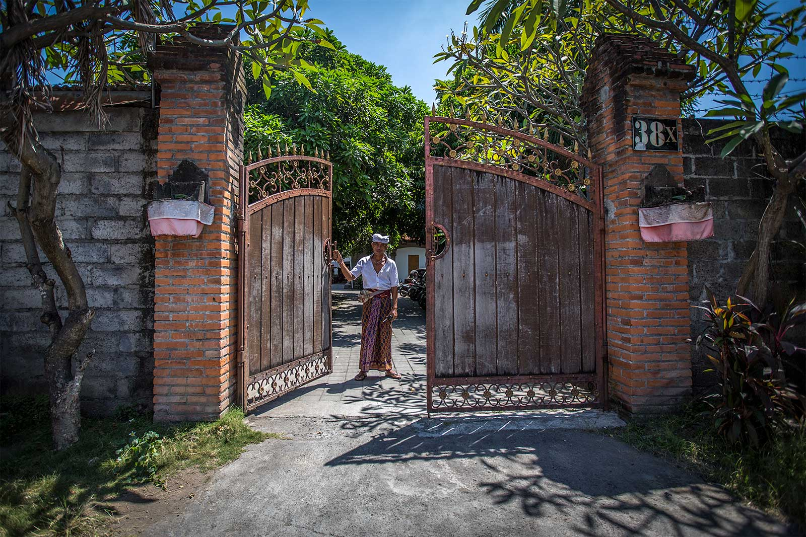 Guard standing at gate Psylo's HQ entrance, Bali