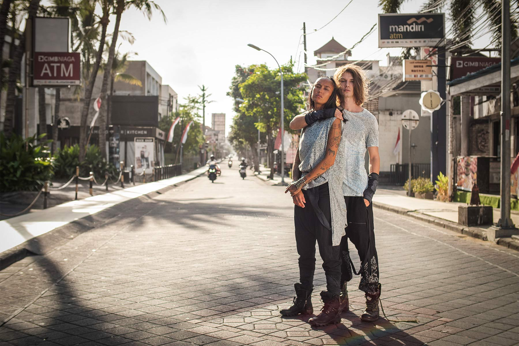 couple wearing Psylo fashion unisex clothing in Kuta's street, Bali